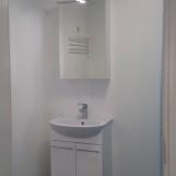 Kylpyhuoneen ovelta, pesukonepaikka vasemmalla