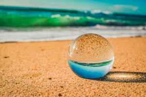 close up photo of crystal ball on sand